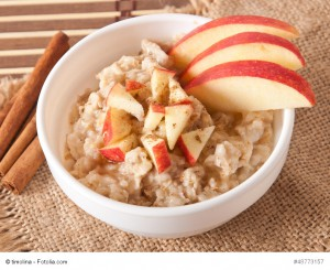 Oatmeal with apples and cinnamon in a white bowl